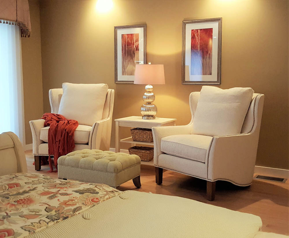 room with white chairs, bright walls and attractive artwork