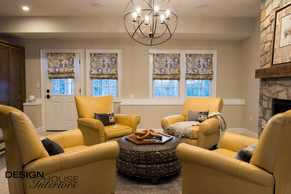 living room with yellow furniture with fireplace and windows