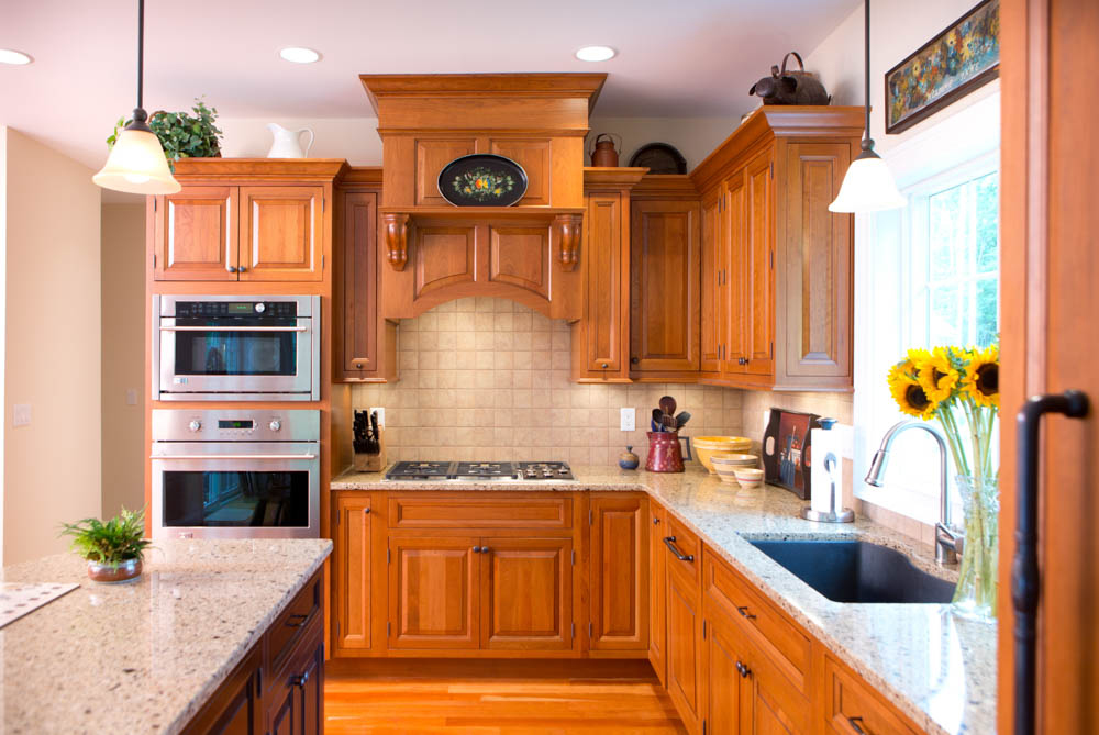 Kitchen With Light Wood Cabinets And Light Beige Granite Countertops
